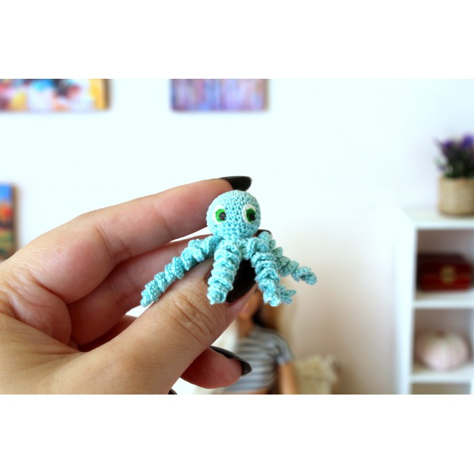 Miniature crochet octopus with hand painted eyes
