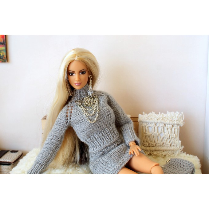 Knitted outfit for Barb doll, sweater, skirt, purse, and earrings.